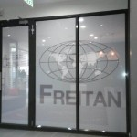 Digitally printed one way vision vinyl applied to glass panels.